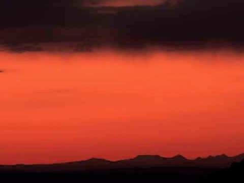 ZO, MS, Silhouette of West Mitten butte at sunrise, Monument Valley Tribal Park, Arizona/Utah, USA