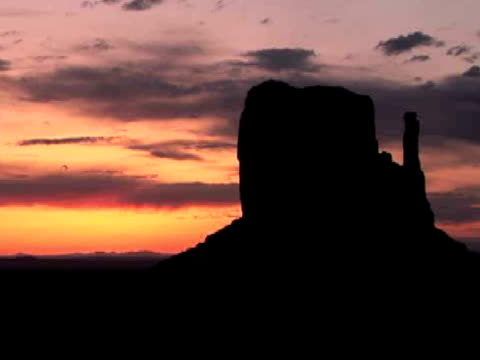 MS, Silhouette of West Mitten butte at sunrise, Monument Valley Tribal Park, Arizona/Utah, USA