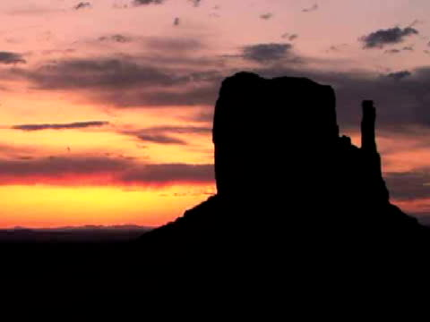 T/L, MS, Silhouette of West Mitten butte at sunrise, Monument Valley Tribal Park, Arizona/Utah, USA