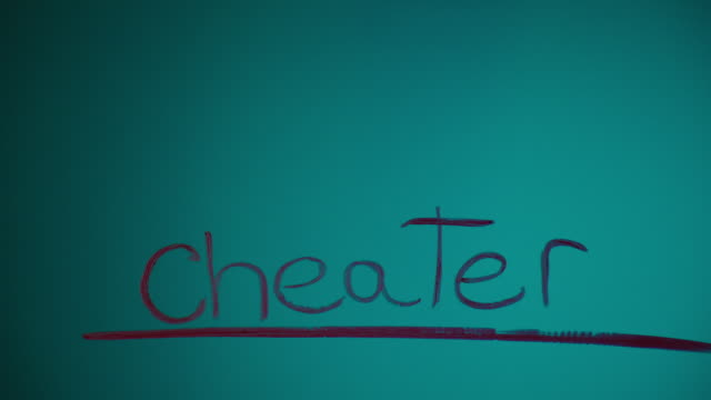 Silhouette of Woman Writing 'Cheater'