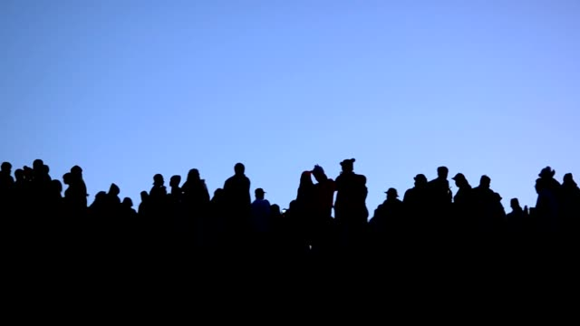 Silhouette :  people waiting for sunrise