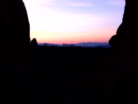 Silhouette rock formations at sunset in Arches National Park, Moab, Utah