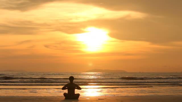 Silhouette Yoga on the beach