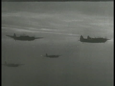 AERIAL Silhouettes of Allied airplane military bombers in flight moving Allied aircraft air raids strikes WWII World War II