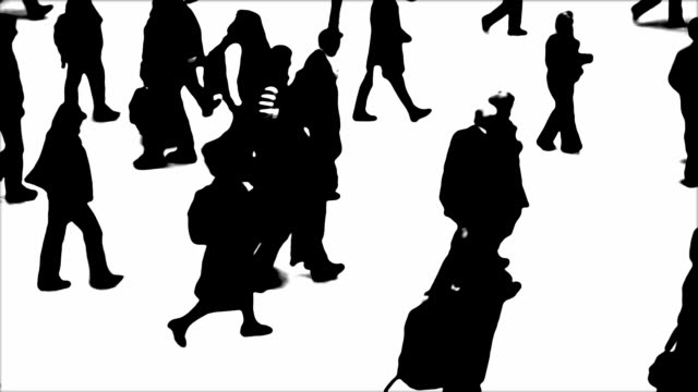 B/W Silhouettes Of City People On The Move