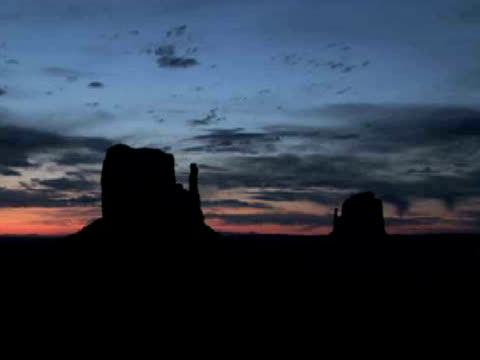 MS, ZI, Silhouettes of East and West Mittens buttes at sunrise, Monument Valley Tribal Park, Arizona/Utah, USA