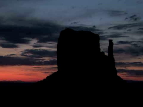 MS, ZO, Silhouettes of East and West Mittens buttes at sunrise, Monument Valley Tribal Park, Arizona/Utah, USA