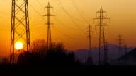 Silhouettes Of Electricity Pylons