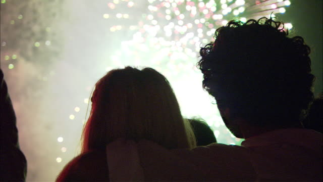 CU Silhouettes of people looking at fireworks, Sydney, New South Wales, Australia