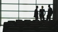 WS R/F Silhouettes of people talking in auditorium, Squamish, British Columbia, Canada