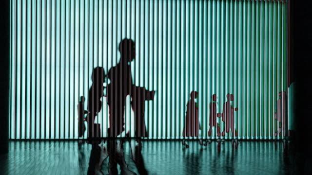 Silhouettes of people walking in Tokyo, Japan