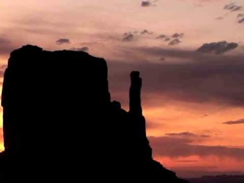 MS, ZO, Silhouettes of the Mittens buttes at sunrise, Monument Valley Tribal Park, Arizona/Utah, USA