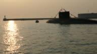 silhouettes submarine at sunset