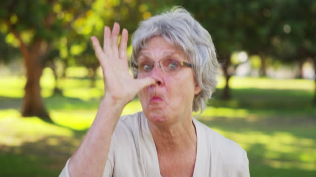 Silly grandma making funny faces at the camera