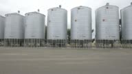 Silos used to fumigate grain infected by weevils stand at a Riordan Group Pty grain depot near Lara Victoria Australia on Tuesday Feb 14 A truck sits...