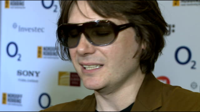 celebrity interviews ENGLAND London INT ***LOTS Manic Street Preachers photocall and interview SOT on winning thrilled nervous A bit strarstruck...