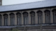 A silver roof tops a church building. Available in HD.