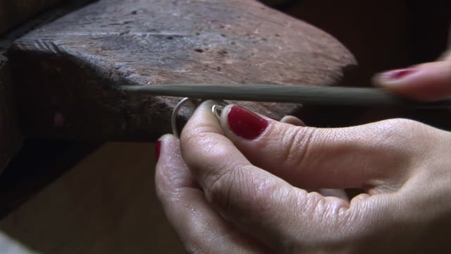 CU, Silversmith shaping silver ring, close-up of hands