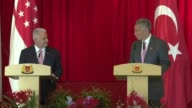 Singapore's Prime Minister Lee Hsien Loong speaks at a joint press conference with his Turkish counterpart Binali Yildirim following their meeting at...