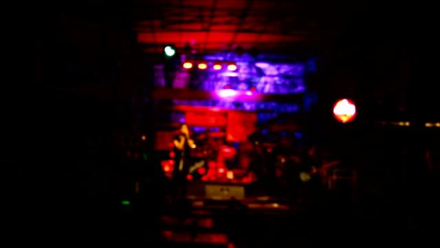Singer in a restaurant: blurred focus.