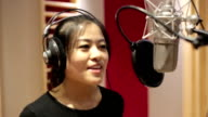 Singer singing in recording studio