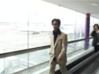 Singer songwriter Prince walks briskly through Heathrow after arriving for a public appearance Wears neat suit and walks with hands in pocket / audio...