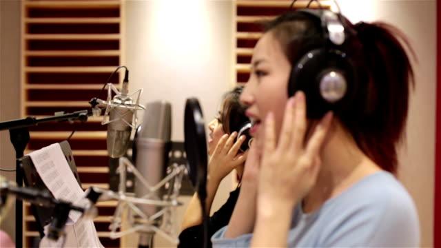 Singers singing in the studio