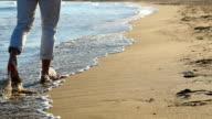 Single men walking along the beach.