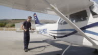 Single-engine aircraft Cessna 172RG being cleaned with pressure washer, RED R3D 4k