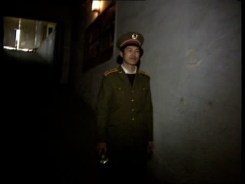 Heilongjiang Province Harbin BV Security guard entering bombshelter tunnels now used as factories MS Ditto BV Ditto MS Slogan of Chairman Mao Zedong...