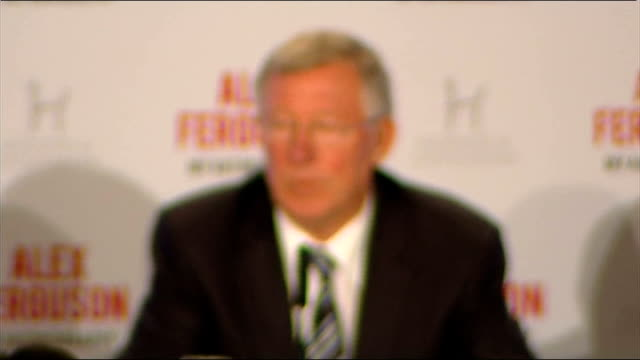press conference Ferguson seated as press photographers disperse Sir Alex Ferguson press conference SOT Responds to Chinese journalist asking him to...