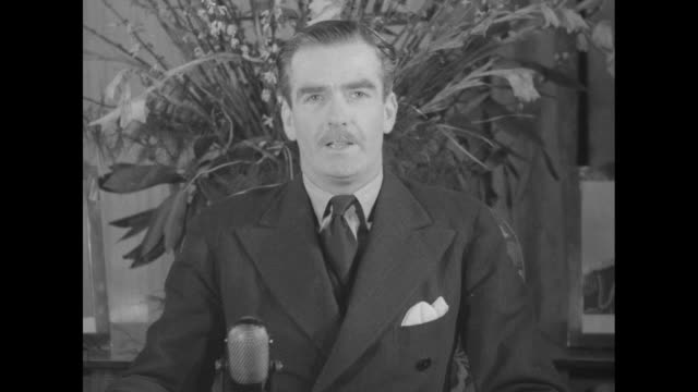 SOT Sir Anthony Eden speaks of hardships of ongoing war and eventual victory / reporters taking notes / Note film has nitrate deterioration