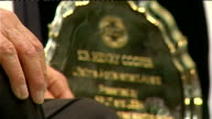 Sir Henry Cooper interview Cooper in boxing ring giving interview / Lifetime Achievement Award for Sir Henry Cooper displayed on table during...