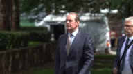 Sir Norman Bettison walking past families of victims of the Hillsborough disaster as he enters court for a criminal trial into the tragedy