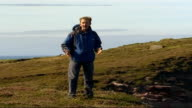 Sir Ranulph Fiennes training for Eiger climb SCOTLAND Orkney EXT Reporter to camera PULL OUT to Old Man of Hoy beside