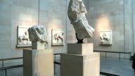 Elgin Marbles statue general views Elgin Marbles on display / Empty plinth [Where headless sculpture of the god Illissos usually stands but currently...