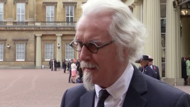 Sir William Connolly speaks outside Buckingham Palace after receiving a knighthood from the Duke of Cambridge Southampton Captain Steven Davis also...