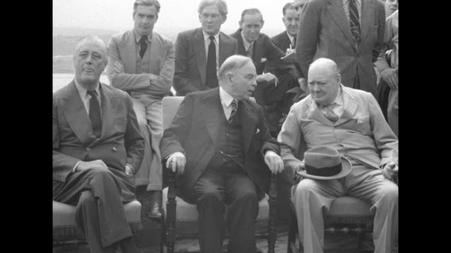 Sitting and posing for photo opportunity from left to right US President Franklin Roosevelt Canadian Prime Minister Mackenzie King and British Prime...