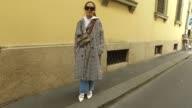 Siyan Chen wearing Topshop coat Champion hoodie Zara jeans korean shoes Gucci bag and Céline sunglasses is seen during Milan Fashion Week...