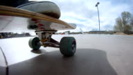 MS POV Skateboard riding at skate park and looking up as board is picked up / Denver Colorado, United States