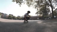 A skateboarder rides through the streets of Brooklyn