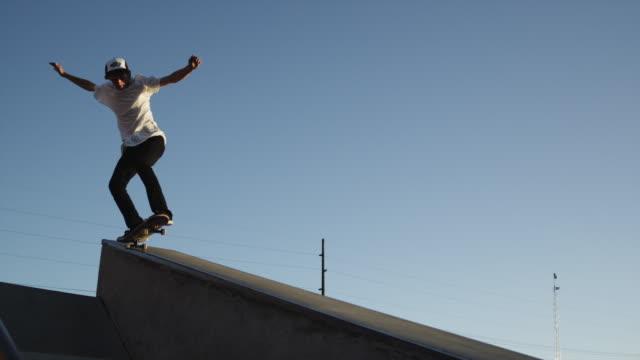 WS TS MS Skateboarder sliding ramp in skatepark / Orem, Utah, USA