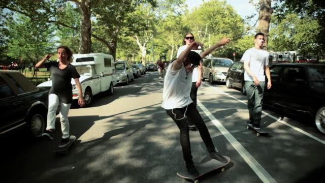 Skateboarders skating on a street
