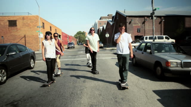 Skateboarders skating on street