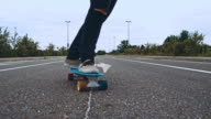 Skateboarding on a road intersection