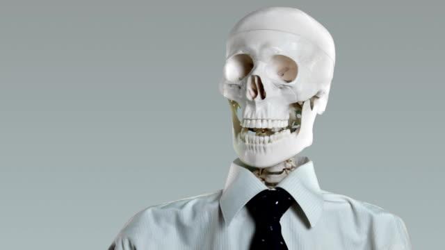 Skeletal office worker talking