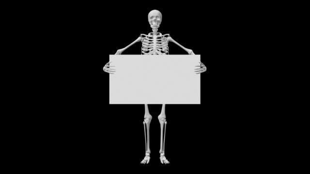 skeleton holding sign