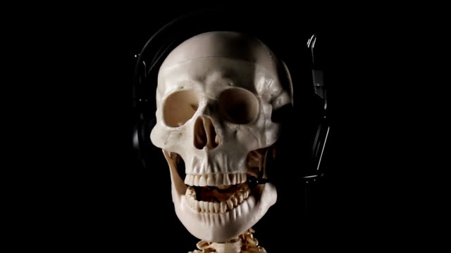 Skeleton talking with headphones