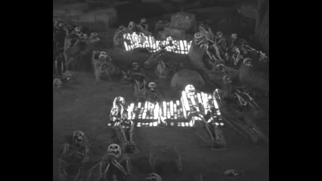 VS skeletons with their skulls lying on ground in ruins of lodge on the grounds of Fountain of Youth Archaeological Park/ shot of exterior of old...