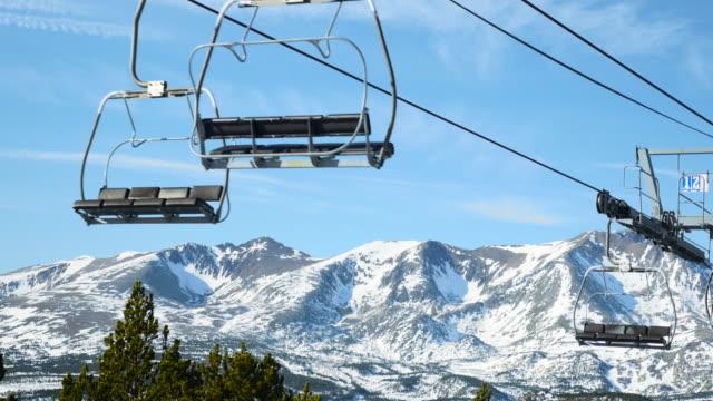 ski lift and snowy mountain.